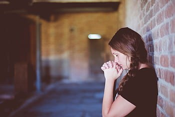 people-girl-alone-praying-wall-chapel-royalty-free-thumbnail