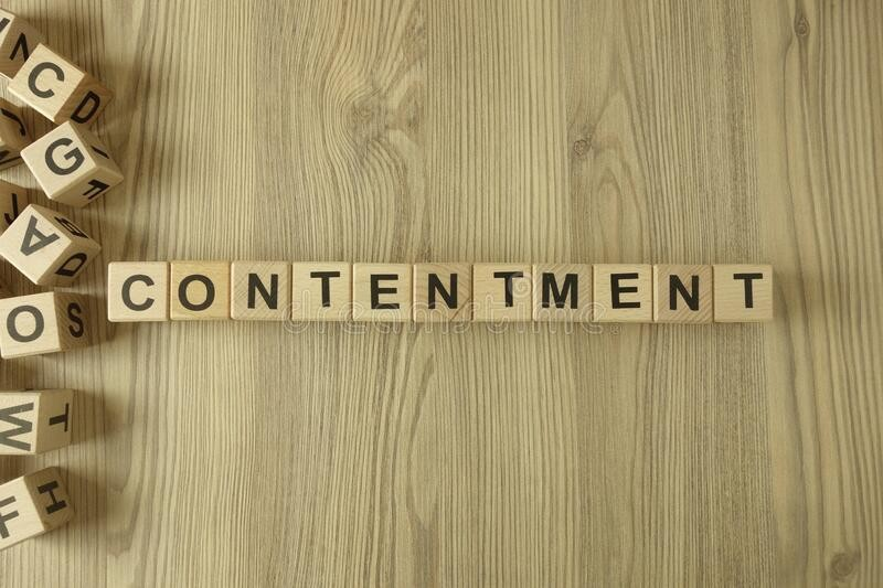 word-contentment-wooden-blocks-desk-177063014